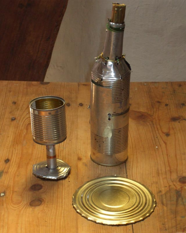 Glass and bottle - - Orson Buch tin can sculpture