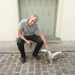 Orson Buch and Basso, his dog sculpture
