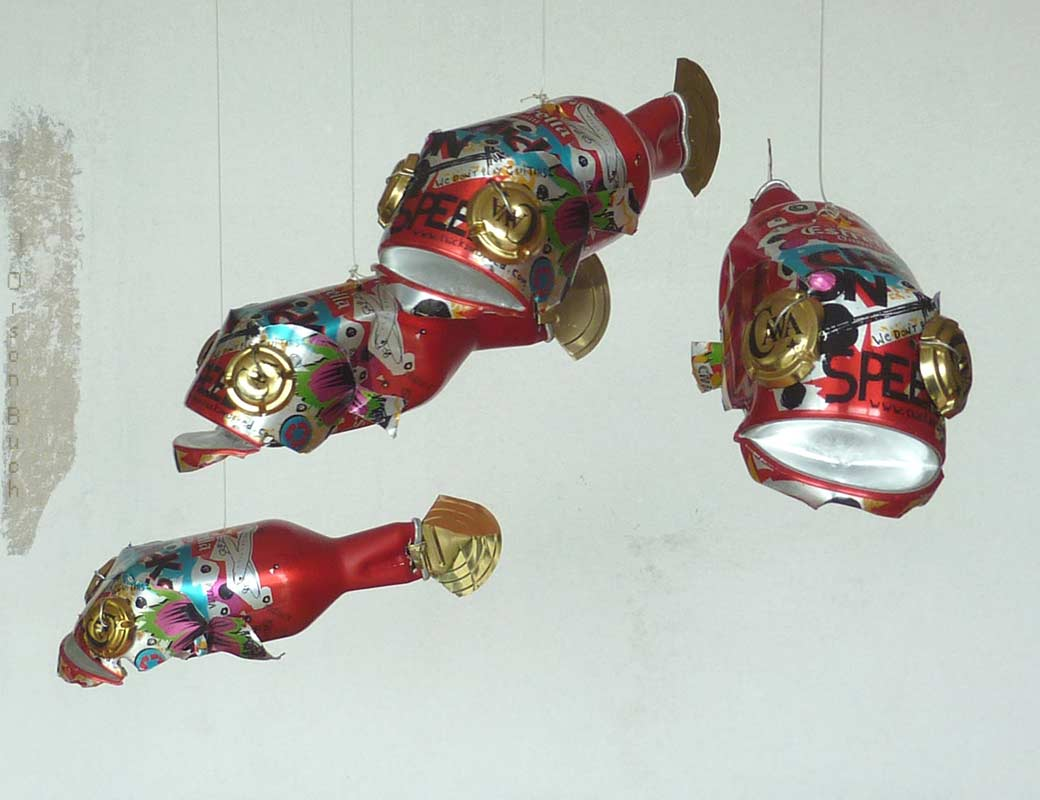 Red fish Orson Buch's tin can sculpture